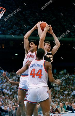 Syracuse's Rony Seikaly (4) fights for a rebound with Providence's Jacek Duda (50) as Syracuse's Derrick Coleman (44) closes in during NCAA semifinal play in New Orleans