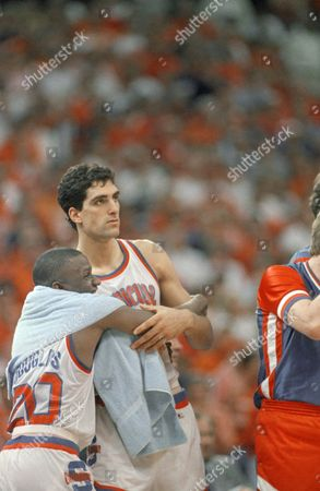 Syracuse's Rony Seikaly and Sherman Douglas (left) celebrate on the sidelines in the closing minutes of the game as the Orangemen defeat Providence, 77-63, in NCAA semi-final play in New Orleans