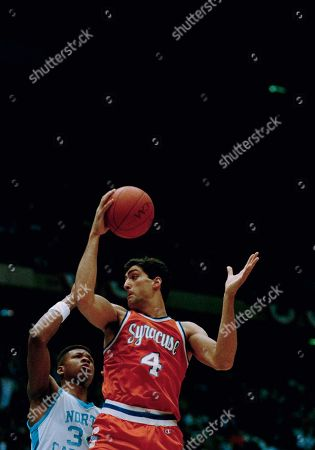 Syracuse's Rony Seikaly, right, grabs the rebound against North Carolina's J.R. Reid, during first half action in the NCAA Regional final in East Rutherford, N.J