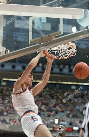 Syracuse center Rony Seikaly slam dunks the ball during the second round NCAA East Regional game against Rhode Island in Chapel Hill, N.C