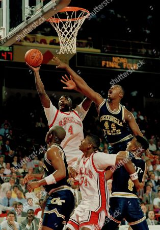 Larry Johnson, Johnny McNeil, James Jones, Brian Oliver, Dennis Scott UNLV Runnin' Rebel forward Larry Johnson (4) goes for the hoop as Georgia Tech's Johnny McNeil stretches to block his shot during first half action of the NCAA Semi-final game in Denver, . Boxing in Rebel James Jones (center) are Tech's Brian Oliver (left) and teammate Dennis Scott