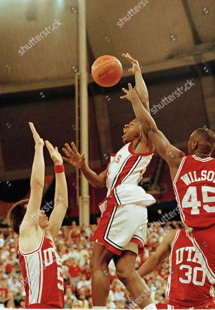 Anthony Grant Wilson UNLV's Greg Anthony (50) goes to the basket between Utah's Josh Grant (5) and Byron Wilson (45) in their NCAA Western Regional game in Seattle, . Nevada won and will go on to meet Seton Hall on Saturday