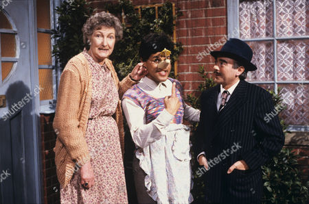 Gary Wilmot (centre) and Pat Coombs (left) in 'Cue Gary' - 1988