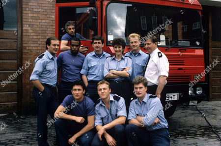L-R back row Richard Walsh , James Hazeldine (in cab) , Gary MacDonald , Gerard Horan , Katherine Rogers , Rupert Baker and James Marcus.front row Mark Arden , Jerome Flynn and Sean Blowers in 'Londons Burning' Film - 1986