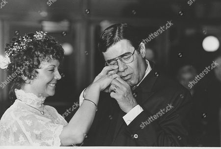 Lewis Pitnick Comedian Jerry Lewis hams it up for the camera as he pretends to examine his bride Sam's wedding ring at their marriage ceremony in Key Biscayne, Fla., . Lewis married 32-year-old SanDee Pitnick, a Las Vegas dancer, in a small private ceremony