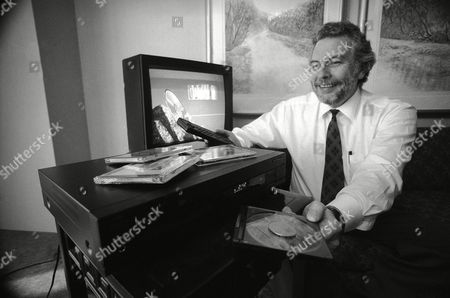 Stock Picture of Electronics Nolan Bushnell, general manager of interactive products at Commodore, demonstrates the Commodore CDTV Interactive Multimedia player in New York, . The unit, which retails for $999, combines the features of a home computer, video game and conventional CD player
