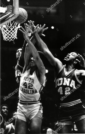 Brad Daugherty, Tony Hargraves, Gary Springer Brad Daugherty (42) reaches to grab the rebounding ball before Iona College's Tony Hargraves, left, and Gary Srpinger (42) during their game at New York's Madison Square Garden, . North Carolina beat Iona 74-61