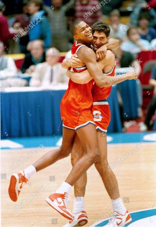 Syracuse's Rony Seikaly and Derrick Coleman, left, hug at the buzzer after they defeated North Carolina in the NCAA Eastern regionals at the Meadowlands Arena
