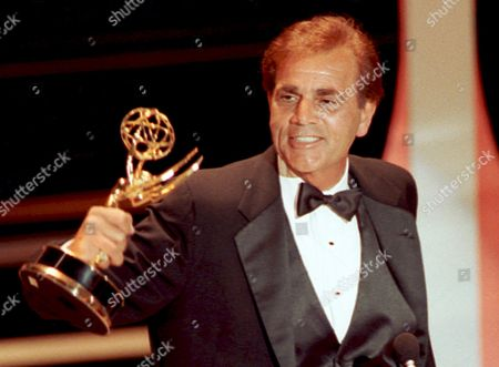 """Alex Rocco Actor Alex Rocco holds up his Emmy award for best supporting actor in a television comedy series for his role in """"The Famous Teddy Z,"""" during his acceptance speech at the 42nd Annual Primetime Emmy Awards in Pasadena, Calif. Rocco, the character actor best known for playing the bespectacled Las Vegas mobster Moe Greene in """"The Godfather,"""" has died, his daughter announced . He was 79"""