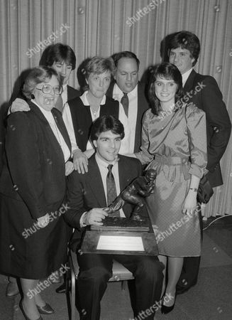 """Doug Flutie, Denise Flutie, Darren Flutie, Joan Flutie, Richard Flutie, Laurie Fortier, Billy Flutie Boston College quarterback Doug Flutie poses with his family and the Heisman Trophy he was awarded, in New York. From left are: Flutie's sister Denise, his brother Darren, his mother Joan, his father Richard, his girlfriend Laurie Fortier, and his brother Billy. Doug Flutie says both of his parents died within an hour of each other. Flutie said, on his Facebook page that father Dick died of a heart attack in a Florida hospital and that mother Joan also suffered a heart attack and died less than an hour later. Flutie wrote: """"They say you can die of a broken heart and I believe it"""