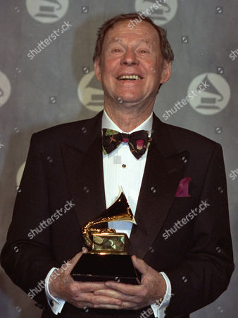 """Songwriter Irving Gordon, shown on at New York's Radio City Music Hall, who wrote """"Unforgettable"""" and won a Grammy for it four decades later after Natalie Cole recorded it as a duet with her late father. Gordon, shown holding his Grammy for Song of the Year, whose songs also were recorded by such greats as Duke Ellington, Billie Holiday, and Patti Page, died of cancer at his home in Los Angeles on Sunday, said his son, William Gordon. He was 81"""