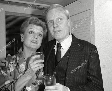 """Angela Lansbury, John McMartin Angela Lansbury and John McMartin toast backstage at their opening performance of """"A Little Family Business"""" at the Martin Beck Theatre in New York. McMartin, the silver-haired, Tony Award-nominated actor whose Broadway career spanned decades, died of cancer, in New York. He was 86"""
