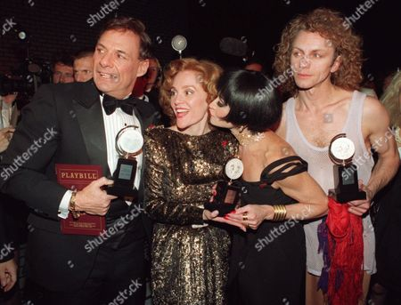 "Stock Picture of CARVER Chita Rivera plants a kiss on the cheek of Madeline Kahn as Ron Leibman, left, and Brent Carver gather together to show off their Tonys back stage at the Gershwin Theater in New York June 7, 1993, following the 1993 Tony Awards. Rivera won for best actress in a musical for her role in ""Kiss of the Spider Woman,"" Kahn for best actress in a play for her role in ""Sisters Rosensweig,"" Leibman for best actor in a play for his role in ""Angels in America"", and Carver for best actor in a musical for his role in "" Kiss of the Spiderwomen"". Kahn, an Oscar-nominated actress and comedian best known for her work in ""Paper Moon"" and ""Blazing Saddles,"" died, of ovarian cancer. She was 57"