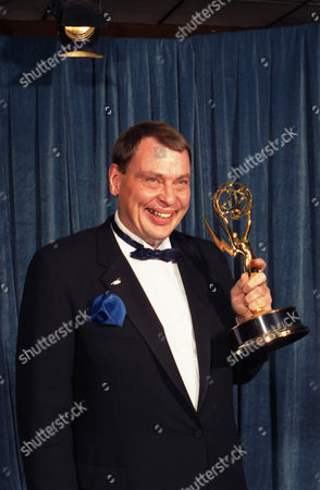 """Larry Drake holds the Emmy he won for best supporting actor in a drama series for his role as a mentally challenged character in """"L.A. Law,"""" at the 40th annual Emmy Awards in Pasadena, Calif. Drake, who earned back-to-back Emmys for his portrayal of Benny Stulwicz, was found dead in his Los Angeles-area home on Thursday, March 17, 2016. He was 66"""