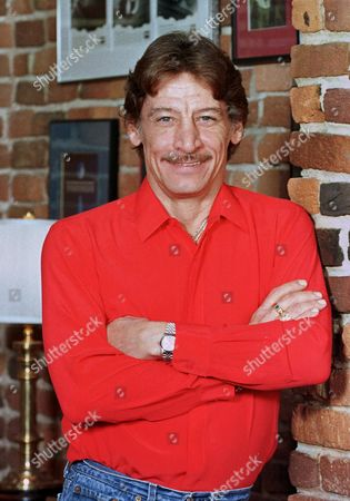 """Stock Image of VARNEY Actor Jim Varney, who portrayed the rubber-faced rube """"Ernest P. Worrell"""" in a series of movie comedies and hundreds of TV commercials, is shown in 1993 in Nashville, Tenn. Varney died of lung cancer, at his home in White House, Tenn., according to his attorney. He was 50"""