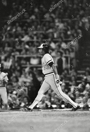Baltimore Orioles Eddie Murray watches his hit fly out of reach in the first inning of a game against the Chicago White Sox, Chicago, Ill. Murrays homer drove in runners Jim Dwyer and Cal Ripken Jr