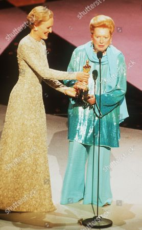 Actress Glenn Close, left, hands an honorary award to Hollywood screen legend Deborah Kerr at the 66th Annual Academy Awards in Los Angles, California