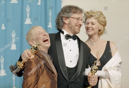 """Adler Capshaw Spielberg Director Steven Spielberg celebrates his numerous Oscars with his wife Kate Capshaw, right, and his mother, Leah Adler, after the 66th Academy Awards in Los Angeles, . Two of Spielberg's films won a total of 10 Oscars, seven for """"Schindler's List,"""" and three for """"Jurassic Park"""