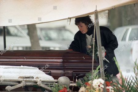 An unidentified mourner puts her hand on the coffin of Cynthia Smith following her funeral in Milton, Massachusetts, . Smith was a 21-year-old student at Syracuse University who was killed in the explosion of the Pan Am jet over Lockerbie, Scotland last month