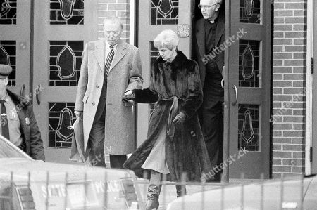 Ed Corrigan, Grace Corrigan Edward Corrigan, father of Christa McAuliffe, helps his wife Grace, right, down the steps of St. Jeremiah?s Church in Framingham, Massachusetts, after about 400 attended a ceremony to remember the hometown girl who ?reached for the stars? and to pray for the strength to go on after her death