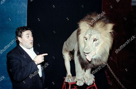 Stock Picture of Giancarlo Parretti, Leo Giancarlo Parretti of Pathé Communications Corp. reacts to the 450-pound lion that was brought to his office in Beverly Hills, Calif., . The tortured $1.36 billion buyout of MGM-UA Communications Co. by Parretti's corporation was completed Thursday. Parretti took possession of the studio and its roaring Leo the Lion trademark Thursday morning