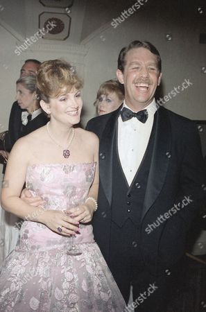 """Stock Photo of Patty Hearst, Bernard Shaw Patricia Campbell Hearst and her husband, Bernard Shaw share a laugh in New York, at the Second Annual Rita Hayworth Gala. The Gala honored actress Jeanne Woodward for her portrayal in """"Do You Remember Love"""