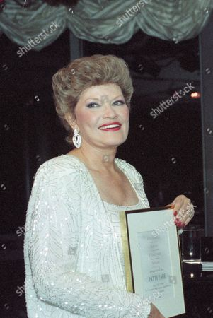 Page Singer Patti Page poses with the first Heritage Artist Award presented to her by Polygram records at the Rainbow Room in New York City