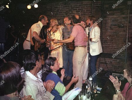 Folk trio celebrate their 25th anniversary at the Bitter End, where their careers began, in New York, . With them on stage are Tom Paxton, Judy Collins and John Denver. From left to right: Paul Stookey, Mary Travers, Paxton, Peter Yarrow (back to camera), Collins and Denver