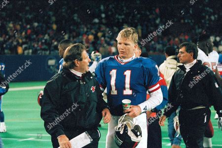 Phil Simms Phoenix Cardinals head coach Joe Bugel, left, congratulates New York Giants quarterback Phil Simms after the Giants defeated the Cardinals 19-17, at Giants Stadium in East Rutherford, N.J