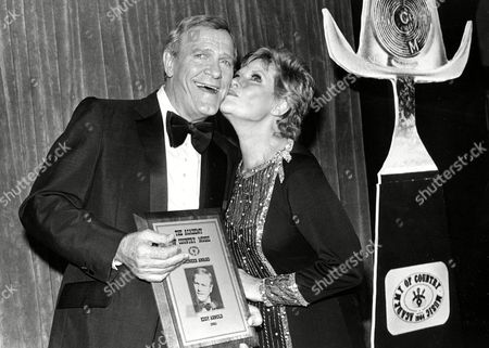 Country Music star Eddy Arnold is kissed by singer Patti Page after receiving the Academy of Country Music's Pioneer Award at the 19th annual award presentation at Knorr's Berry Farm in Buena Park, Calif., on