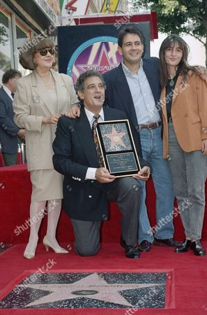 Placido Domingo, Marta Domingo, Placido Domingo Jr., Maria Domingo Opera tenor Placido Domingo poses next to his new star of the Hollywood Walk of Fame with his wife, Marta, left, son Placido Domingo Jr. and his wife Maria, during dedication ceremonies in Los Angeles on . The internationally-known, Spanish born tenor was honored with the 1,989th bronze star on the Hollywood Walk of Fame