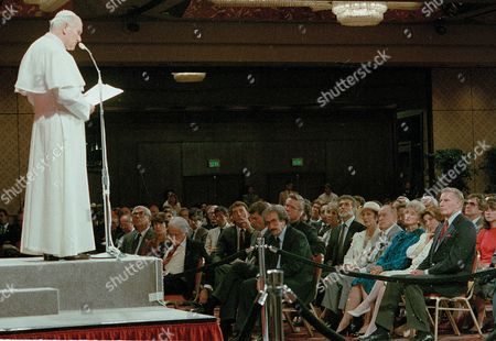 Pope Pope John Paul II talks with the media and entertainment industry professionals at the Registry hotel in Los Angeles, Calif., Tuesday afternoon, . Seated in the audience at the bottom right from front to back are, Charlton Heston, Patty Duke, Delores Hope, Bob Hope, Loretta Young and Ricardo Montalban, with beard. In the front row, looking down, is Jack Valenti