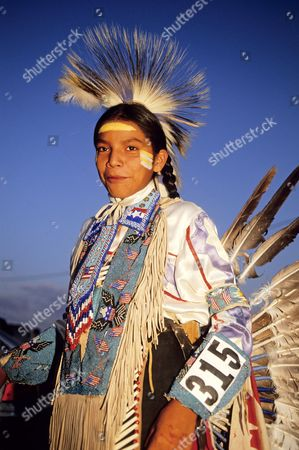 Tatanka Means, the son of Russell Means, the former leader of AIM (American Indian Movement) dancing during a Pow Wow in Window Rock, Arizona. (Pow Wow is a gathering of Native Americans). Arizona, America.