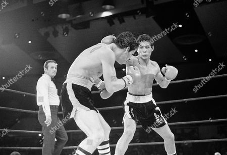 """Hector Macho Camacho, Luis Loy Jr Luis Loy Jr., left, ducks under a blow by Hector Camacho early in a scheduled 10-round junior lightweight boxing bout at Felt Forum in New York. Hector """"Macho"""" Camacho, a boxer known for skill and flamboyance in the ring, as well as for a messy personal life and run-ins with the police, has died, after being taken off life support. He was 50"""