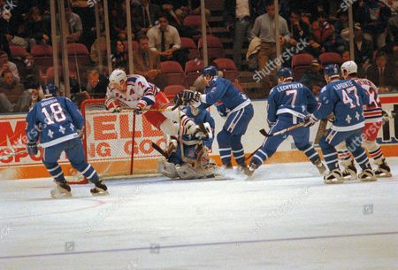Brian Leetch, Kerry Huffman, Ron Hextall, Mike Hough Brian Leetch (2) of the New York Rangers goes airborne as he gets tripped by Kerry Huffman (2), far right, of the Quebec Nordiques during the first period at New York's Madison Square Garden, . Nordiques goalie Ron Hextall and Mike Hough (18) watch the action in front of the net. The Rangers lost 6-3