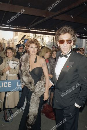 Raquel Welch, Andre Weinfeld Actress Rachel Welch and her husband Andre Weinfeld arrive at New York's Avery Fisher Hall, for the Film Society of Lincoln Center Tribute to Yves Montand each year the film society honors an individual who has devoted his life to the advancement of the cinematic arts. Proceeds from the tribute help finance the New York Film Festival