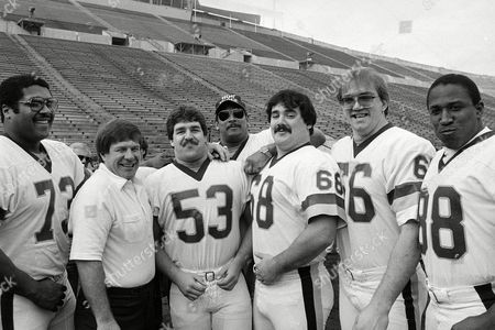 "Mark May, Joe Bugel, Jeff Bostic, George Starke, Russ Grimm, Joe Jacoby Members of the Washington Redskins ""Hogs"" gather for a portrait during picture day activities in Tampa, Fla., . The ""Hogs"" are, from left: guard Mark May; assistant head coach-offense Joe Bugel; center Jeff Bostic; tackle George Starke; guard Russ Grimm and tackle Joe Jacoby"