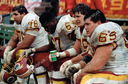 From left to right, Washington Redskins players Ed Simmons, Ray Brown, Jim Lachey and Mark Schlereth sit on the bench in the final minutes of the NFC divisional playoffs against the San Francisco 49ers at Candlestick Park in San Francisco on . The 49ers beat the Redskins 20-13