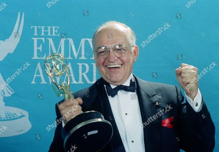 "Richard Dysart Actor Richard Dysart grasps the Emmy Award he won for Best Supporting Actor in a Drama Series for his role in ""L.A. Law"" during the 44th annual Emmy Awards in Pasadena, Calif"