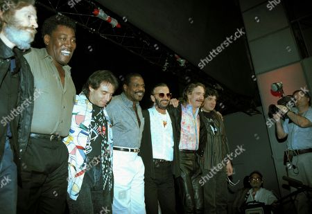 Starr Preston Lofgren Danko Ringo Starr, wearing dark glasses, poses with band members during a news conference at New York's Palladium to announce their upcoming U.S. tour, . Ringo doesn't play with just anyone; all stars in their own right, from left are: Levon Helm, Clarence Clemons, Nils Lofgren, Billy Preston, Ringo, Joe Walsh and Rick Danko