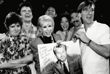 "Comedian Joan Rivers, center, holds up a poster of Jack Paar, former host of NBC's ""Tonight Show,"" which was given to her by the cast of National Lampoon's ""Class of ?86"" in New York, . Rivers will host her own late night talk show this fall, competing with the ""Tonight Show"" and current host Johnny Carson. With Rivers are from left: Annie Golden, Rodger Bumpus, Tommy Koenig, Veanne Cox, John Michaels Higgins, and Brian Brucker O?Connor"