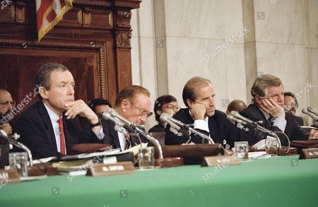Senate Judiciary Committee Chairman Joseph Biden, D-Del., left, and Sen. Edward Kennedy, D-Mass., right, listen during witness confirmation hearings for Supreme Court nominee Robert H. Bork, in Washington. Far left is Orrin Hatch, R-Utah, and Strom Thurmond, R-S.C