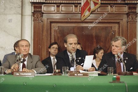 Senate Judiciary Committee Chairman Joseph Biden, D-Del., center, reads from his tally sheet following the committee's voice vote to recommend Robert H. Bork for the Supreme Court, in Washington. Sen. Strom Thurmond, R-S.C., left, and Sen. Edward Kennedy, D-Mass., listen