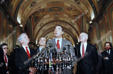 Senate Majority Leader Robert Dole R-Kan., talks with reporters during a Press Conference at the Capitol in Washington, . Dole and two Senators discussed a memorial to be painted on the wall of the Capitol in memory of the space shuttle tragedy. With Dole from left is, Sen. Robert Byrd, D-W.Va; Jake Garn, R-Utah; Dole; and John Clean, D-Ohio