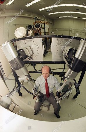 Richard Adams of the Central Research Laboratories of Red Wing, Minn., demonstrates the use of a robot as NASA's Goddard Space Flight Center in Greenbelt, Maryland on . NASA hopes to use remote control devices for work outside of the shuttle and eventually at space stations
