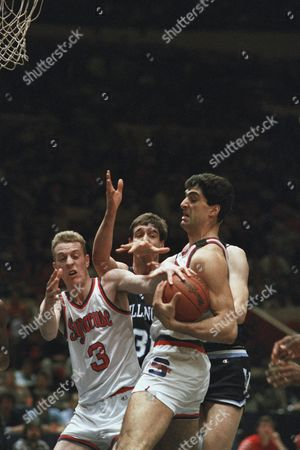 Syracuse's Rony Seikaly, right, battles teammate Matt Roe (3) and Villanova's Mark Plansky, center, for possession of the ball in first-period action at New York's Madison Square Garden, in New York in the Big East Conference Championship Game