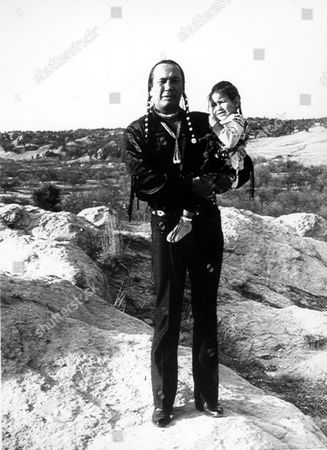 RUSSEL MEANS TATANKA Lakota Sioux Indian and Russel Means is holding his son, Tatanka, on a hill near his home in Porcupine, SD., on . Means is a principal leader of the American Indian Movement