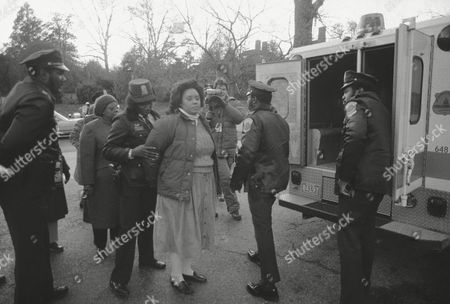 Santita Jackson The Rev. Jesse Jackson's daughter, Santita, center, and Rep. Cardiss Collins, D-Ill, far left behind the police office, are led to a waiting police vehicle after they were arrested outside the South African Embassy in Washington on . They were charged with protesting within 500 feet of the embassy, a misdemeanor. Collins became the 11th member of Congress to volunteer for arrest in the almost-daily ritual that began on November 21