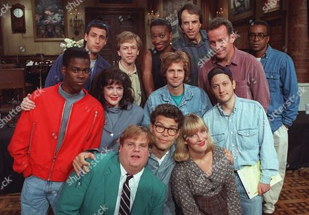 """Stock Image of SWEE The cast of NBC's """"Saturday Night Live"""" pose on the show's set in New York, . From left, front row, are: Chris Farley, Al Franken and Melanie Hutsell. In middle row, from left, are: Chris Rock, Julia Sweeney, Dana Carvey and Rob Schneider. In back row, from left, are: Adam Sandler, David Spade, Ellen Cleghorne, Kevin Nealon, Phil Hartman and Tim Meadows"""