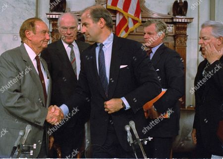 Senate Judiciary Committee Chairman Joe Biden (D-Del.) shakes hands with fellow panel member Sen. Strom Thurmond (R-S.C.), after the committee voted 9-5 to not recommend Judge Robert Bork for the Supreme Court, . Looking on are Senators Patrick Leahy (D-Vt.) and Edward Kennedy (D-Mass), right. Thumond, ranking Republican, voted for the nomination